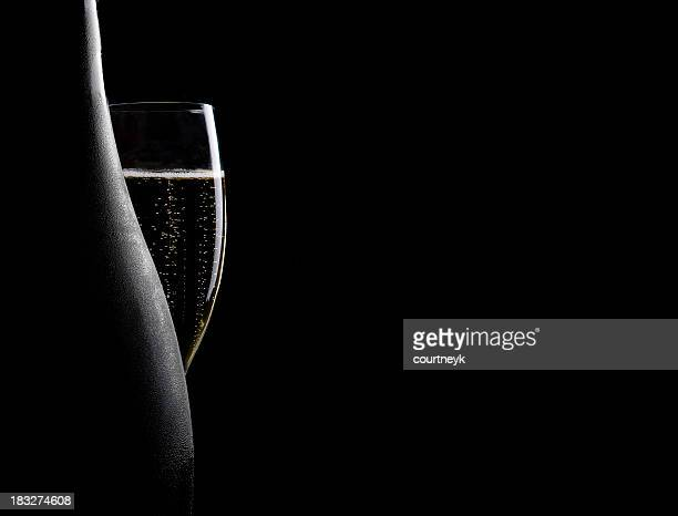 glass and bottle of champagne - champagne stock pictures, royalty-free photos & images