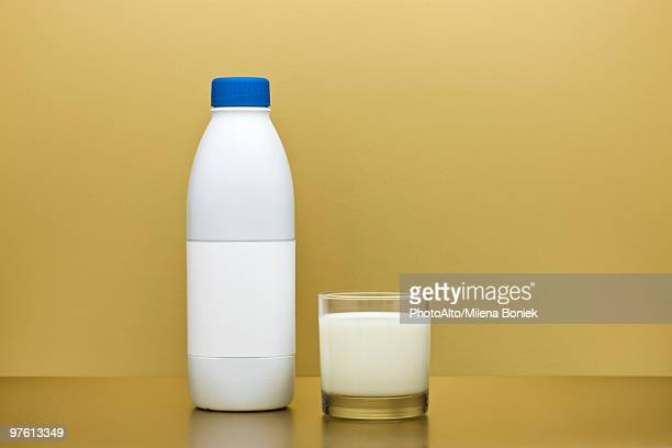 glass and bottle of milk - milk bottle stock pictures, royalty-free photos & images