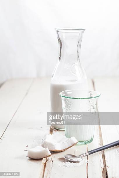 Glass and carafe of homemade coconut milk