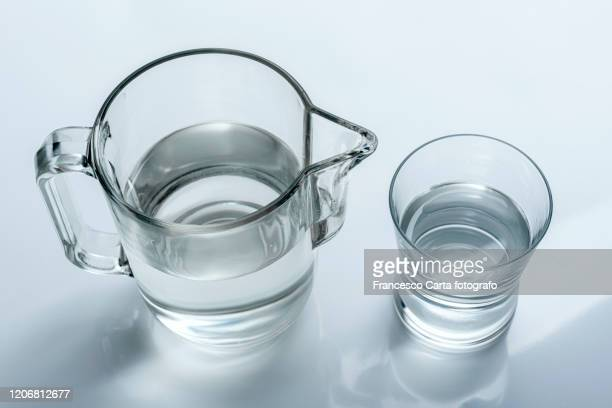 glass and jug water - tempio pausania stock pictures, royalty-free photos & images