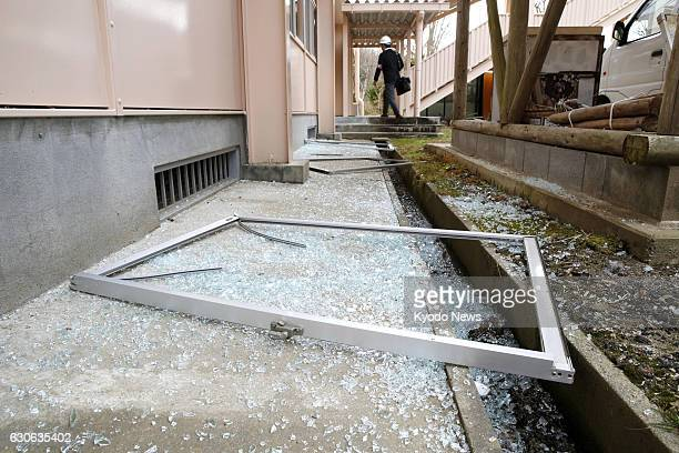 Glass at a school gymnasium is shattered in Takahagi, Ibaraki Prefecture, northeast of Tokyo on Dec. 29 after a magnitude-6.3 earthquake struck...