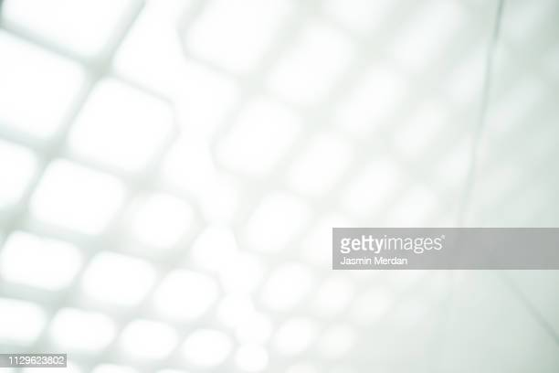 glass background roof of airport in venice, italy - bokeh museum stock photos and pictures