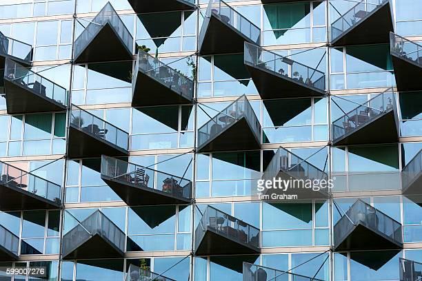 Glass balcony modern architecture new high rise homes development Orestads Boulevard in Orestad City area on June 24 2015 in Copenhagen Denmark