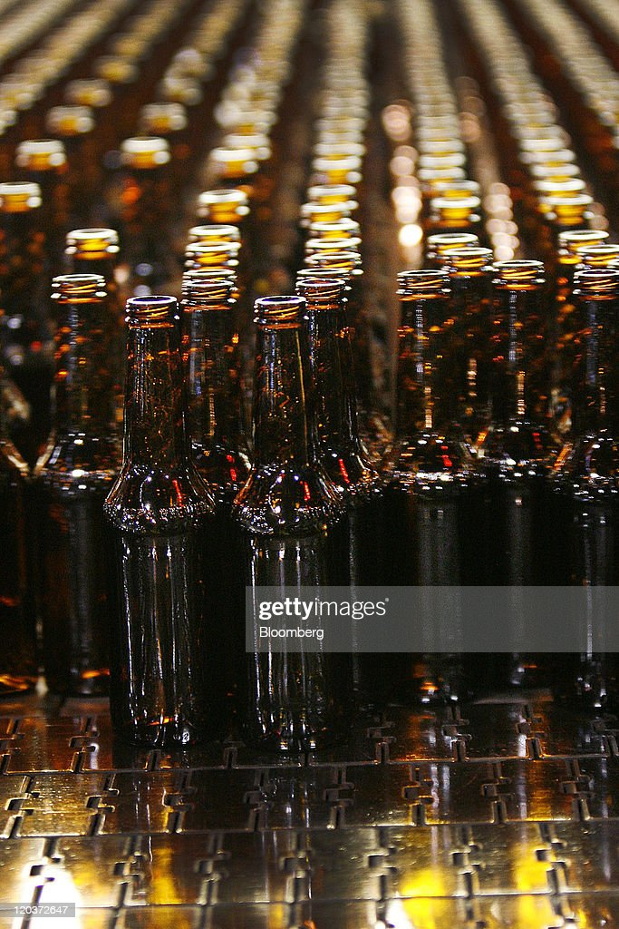 Glass beer bottles stand at the Owens-Illinois Inc. glass manufacturing plant in Waco, Texas, U.S., on Thursday, Aug. 4, 2011. Owens-Illinois Inc., the world's largest glass container manufacturer, delivers safe, effective and sustainable glass packaging solutions to a growing global marketplace. Photographer: Mike Fuentes/Bloomberg via Getty Images