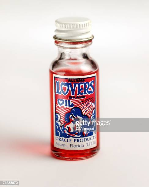 glass bottle of lovers oil - potion stock photos and pictures