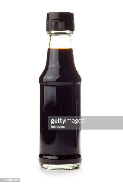Glass bottle of Soy Sauce isolated on a white background