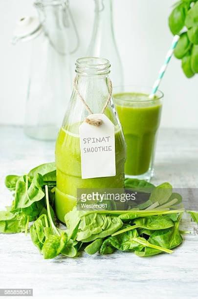 Glass bottle of spinach smoothie