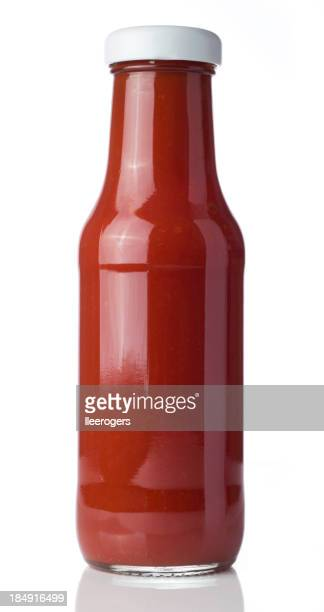 Glass bottle of tomato ketchup on a white background