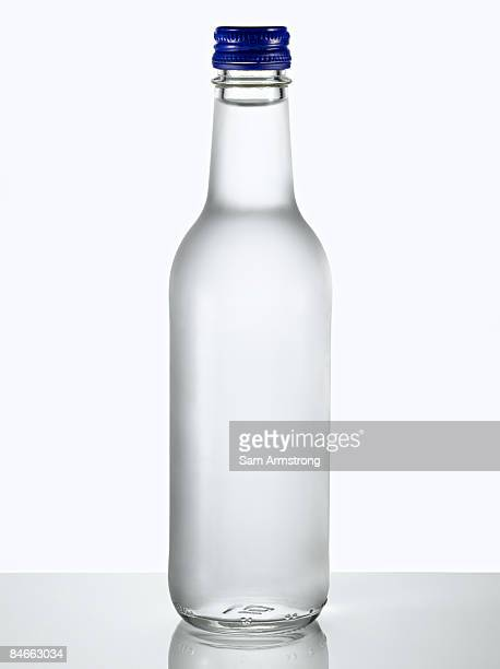 Glass bottle of water.