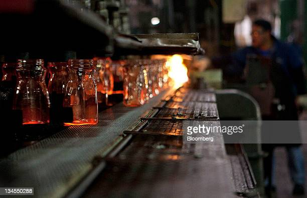 Glass bottles move along a conveyor belt after coming out of an industrial oven at the Vitro SAB plant in Toluca Mexico on Thursday Dec 1 2011 Vitro...