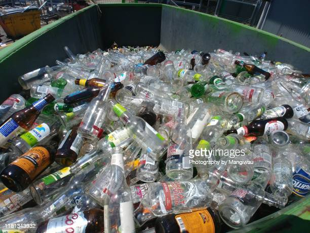 glass bottles recycle - glass material stock pictures, royalty-free photos & images