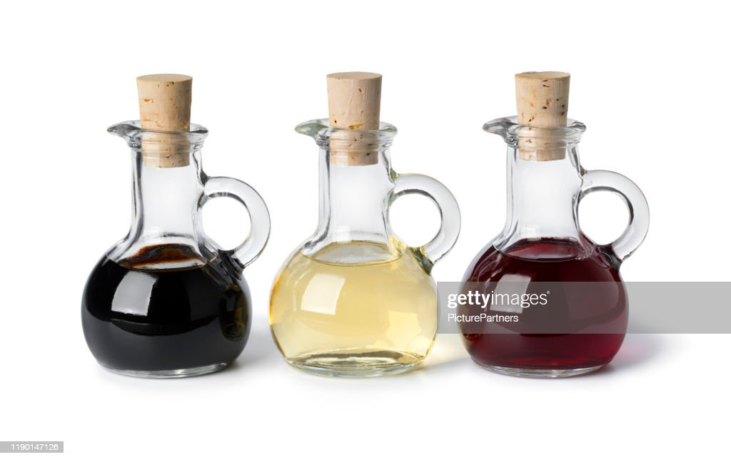 Glass bottles with different types of vinegar : Stock Photo