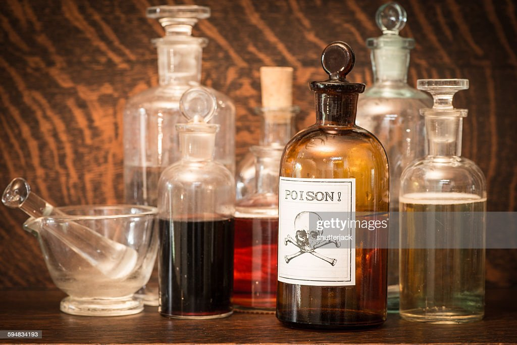 Glass bottles with poison label : Stock Photo