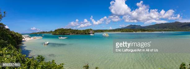 Glass bottom boats in the tropical lagoon beach with clear blue water and white sand in Kabira bay Yaeyama Islands Ishigaki Japan on August 28 2017...