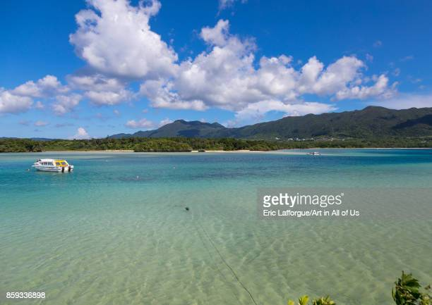Glass bottom boats in the tropical lagoon beach with clear blue water in Kabira bay Yaeyama Islands Ishigaki Japan on August 28 2017 in Ishigaki Japan
