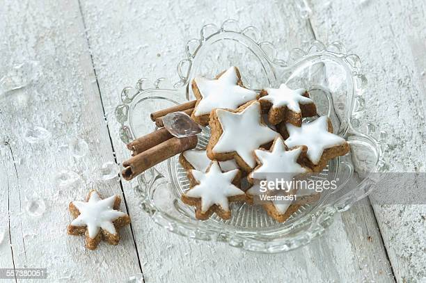 Glass bowl of cinnamon stars and cinnamon sticks