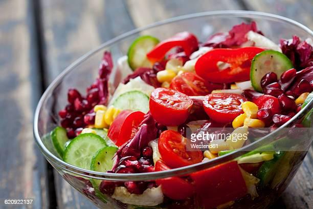 Glass bowl of mixed salad