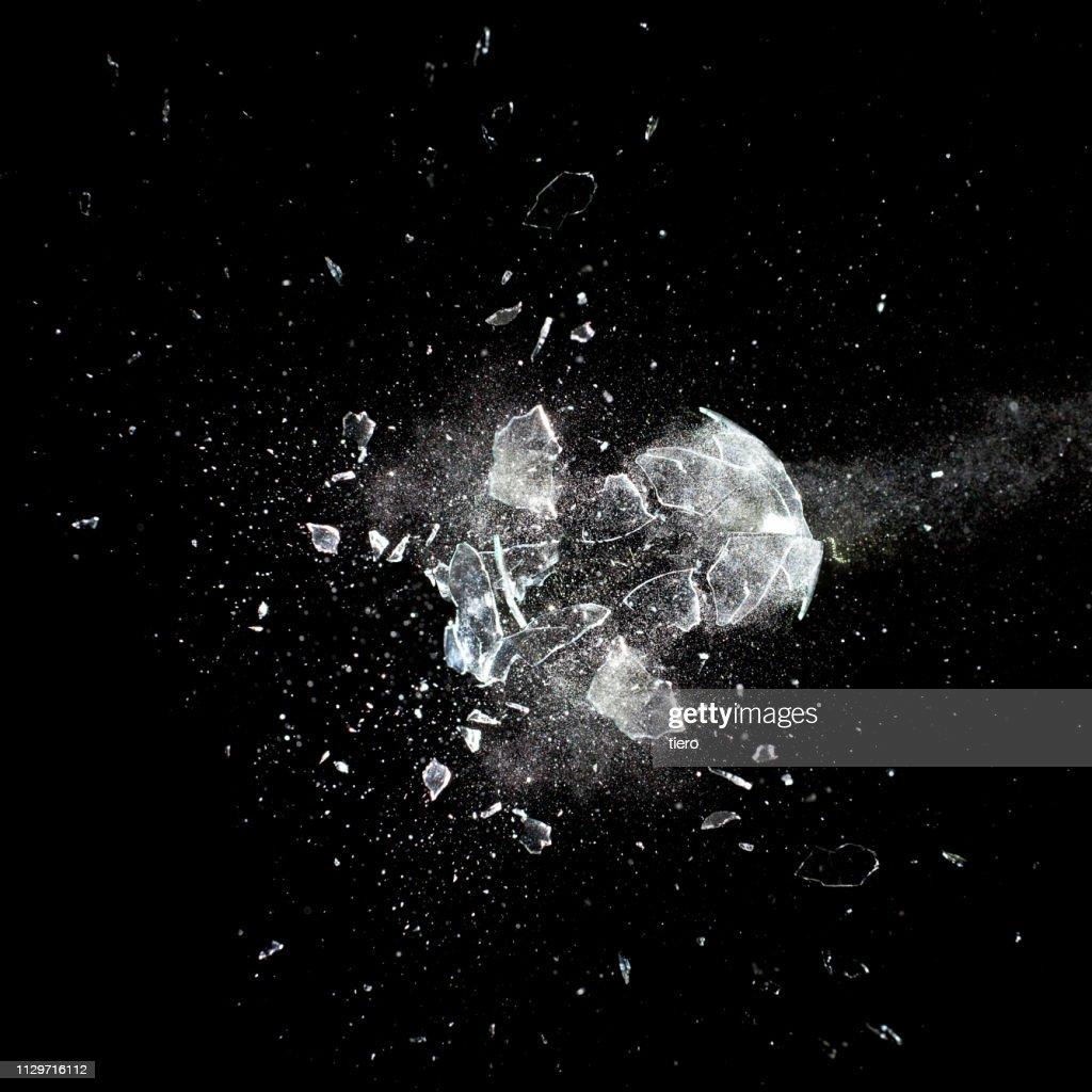 Glass Breaking Against Black Background : Stock Photo