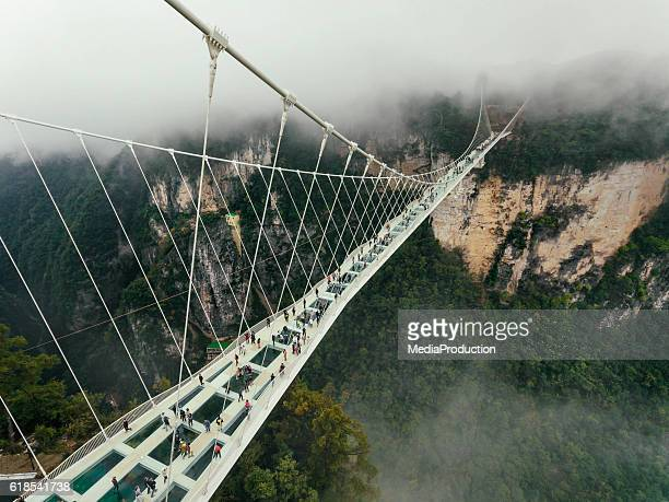glass bridge of zhangjiajie china - suspension bridge stock pictures, royalty-free photos & images