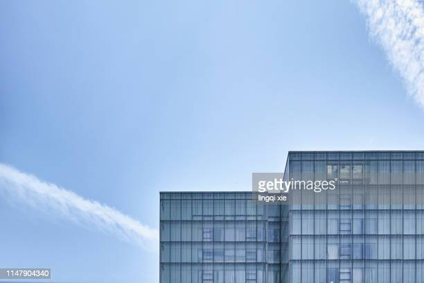 glass building under blue sky and white clouds - high section stock pictures, royalty-free photos & images