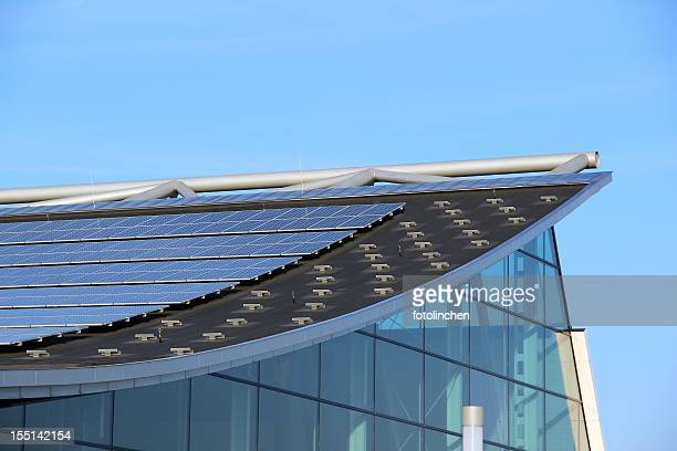 Glass building with solar panels on the roof