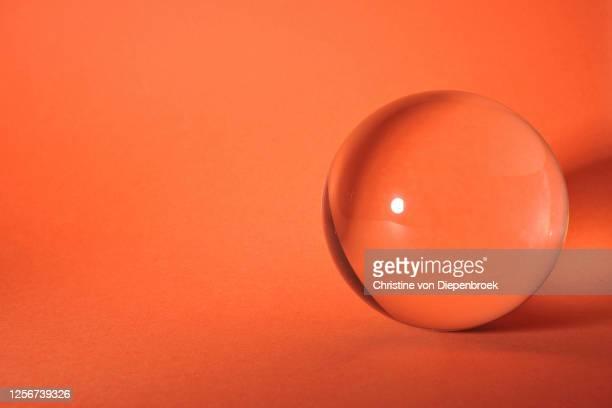 glass bullet on plain background - spielball stock-fotos und bilder