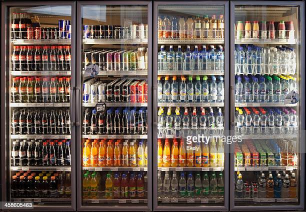 Glass cabinets with diverse range of softdrinks.