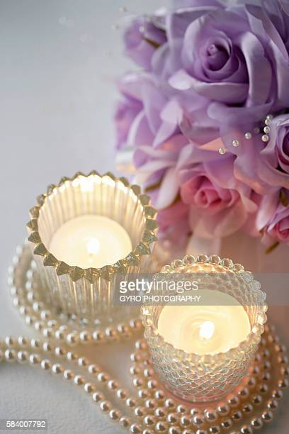 Glass candle holders with pearls and corsage