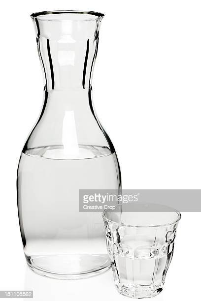 Glass carafe of water with a glass