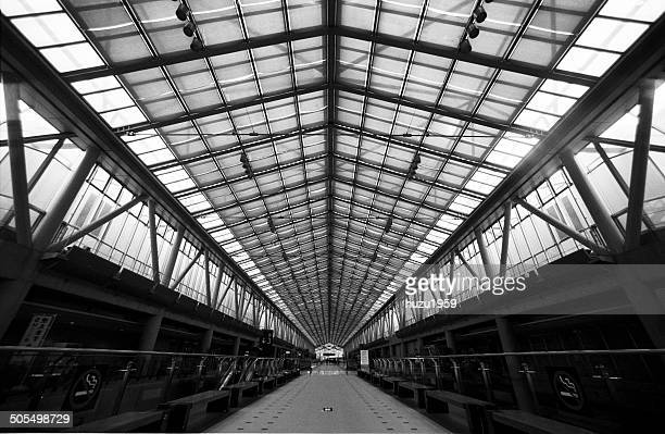 glass ceiling corridor - tokyo big sight stock photos and pictures