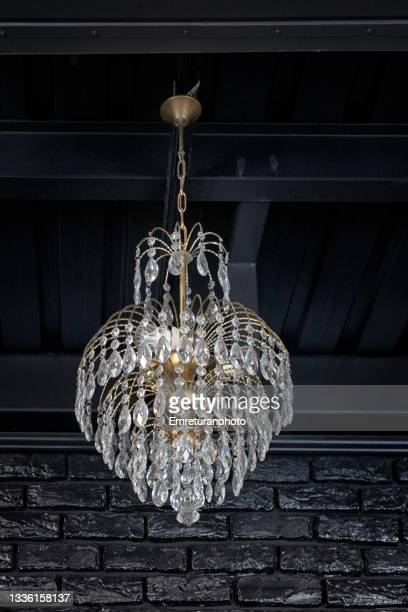 glass chandelier against black background. - emreturanphoto stock pictures, royalty-free photos & images