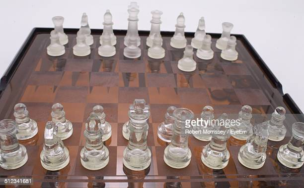 Glass chess pieces on board