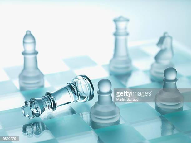 Glass chess pieces on glass chess board