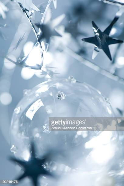 Glass Christmas ornament and star garland, close-up