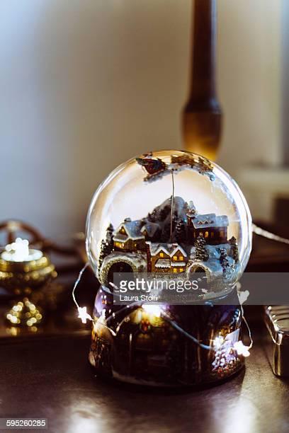 Glass christmas snow globe and lights