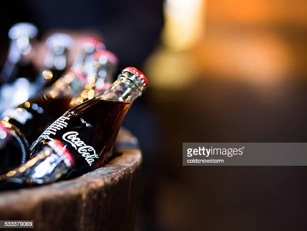 Glass Coca Cola bottles in wooden barrel, Borough Market, London