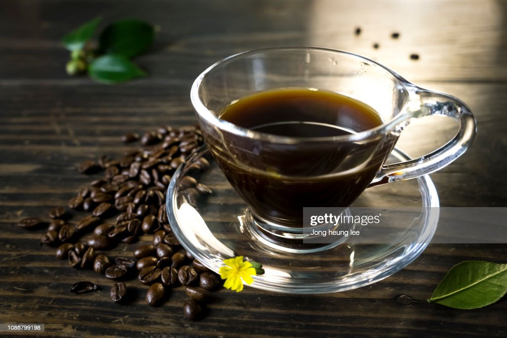 Glass coffee cup set on old table top : Stock Photo