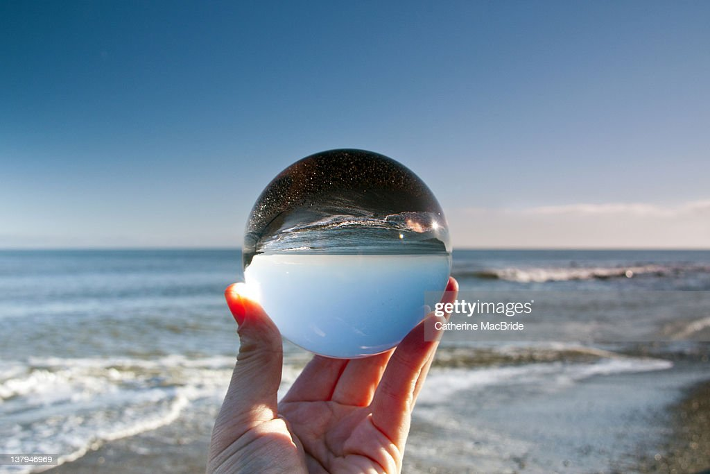 Glass crystal ball held up by hand : Stock Photo