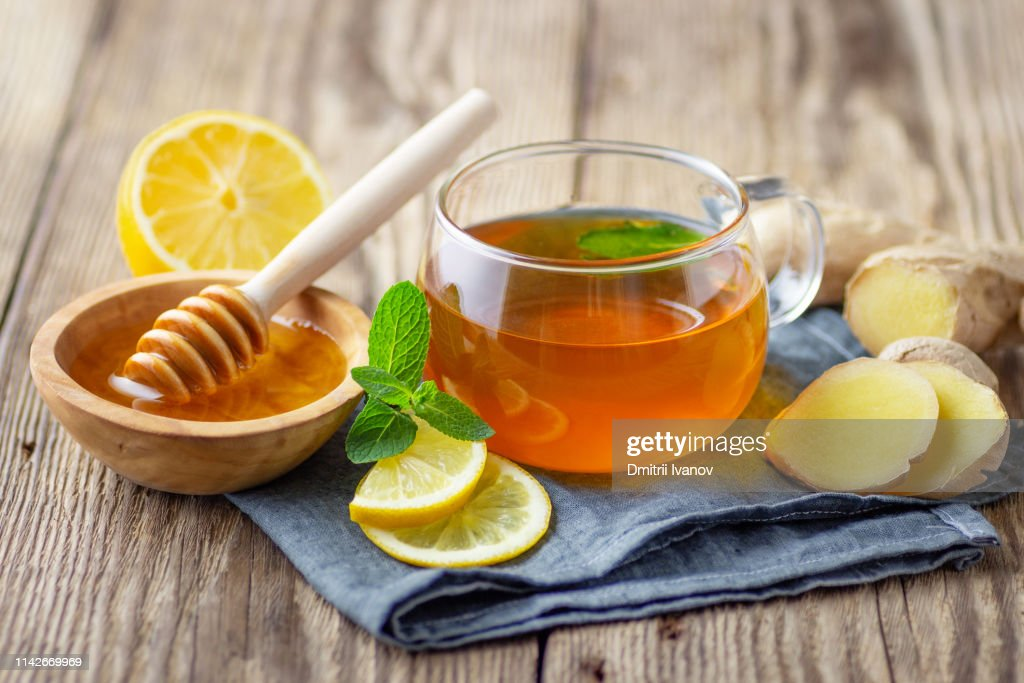 A glass cup of tea with lemon, mint and ginger : Stock Photo