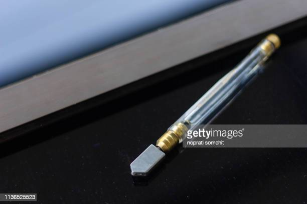 glass cutter tool cutting - glass cutter stock photos and pictures