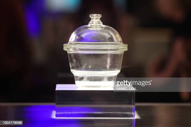 A glass desiccator a jar used in early IVF treatments to keep the petri dish free from moisture is seen on display as part of an exhibition 'IVF 6...