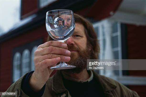 Glass Designer Goran Warff Holding Glass
