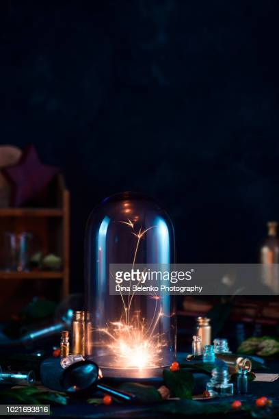 Glass dome with a fireball or a fallen star inside. Precious collection concept. Magical still life with witch or wizard workplace, dark background and copy space