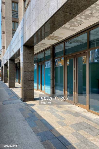 glass door of a building facing the street - sliding door stock pictures, royalty-free photos & images
