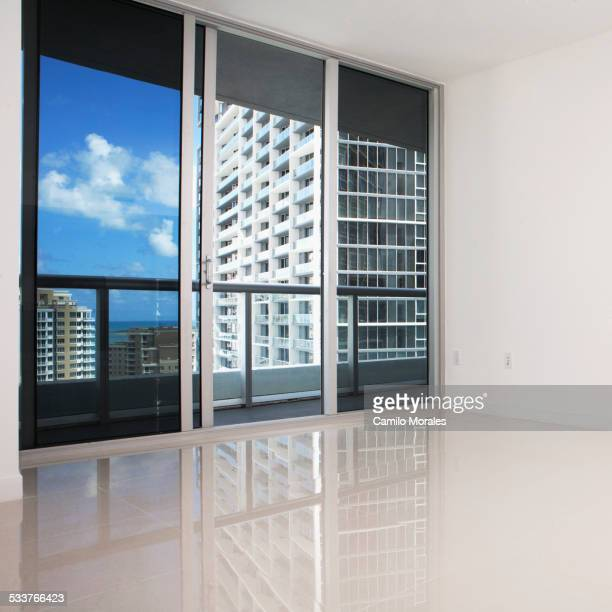 Glass doors and balcony of empty modern apartment