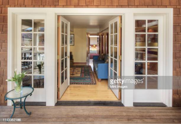 glass doors on wooden patio - french doors stock pictures, royalty-free photos & images