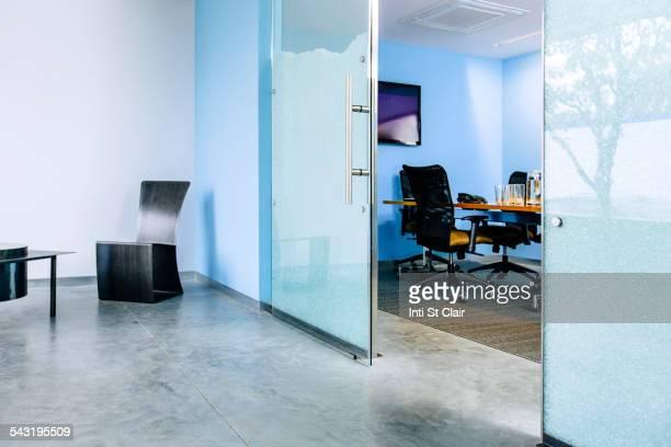 Glass doorway opening to desk in office