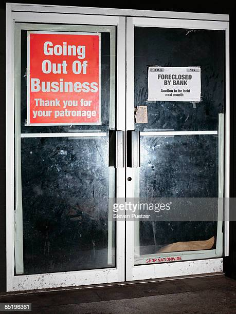 Glass doorway with going out of business sign