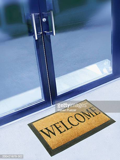 Glass doorway with 'welcome' mat (Digital Composite)