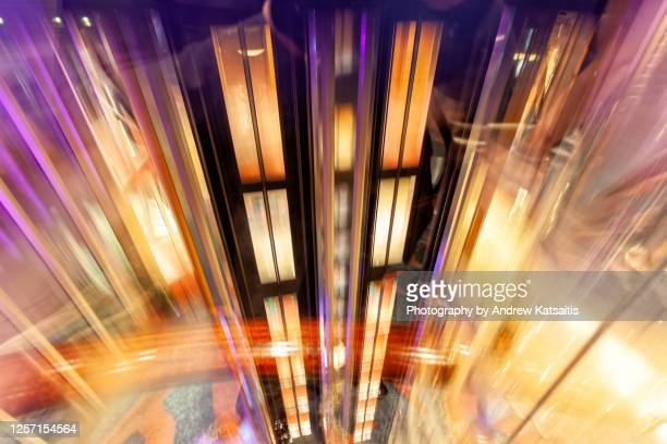 glass elevator in motion - motion stock pictures, royalty-free photos & images